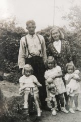 Coralie Richmond, front, centre, with her family who suffered much trauma after her father ended his own life.