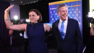 Queensland Opposition Leader Tim Nicholls with deputy opposition leader Deb Frecklington (left) after speaking at the LNP Election function during the night of the 2017 Queensland Election, in Brisbane, Saturday, November 25, 2017. Nicholls joined LNP supporters to watch the election results. (AAP Image/Tracey Nearmy) NO ARCHIVING