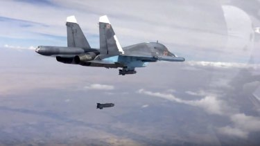 A bomb is released from Russian Su-34 strike fighter in Syria in November.
