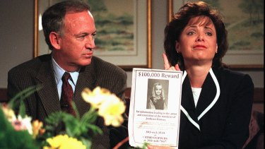 John Ramsey looks on as his wife, Patsy, as they appeal for more information about the death of JonBenet Ramsay in 1997.
