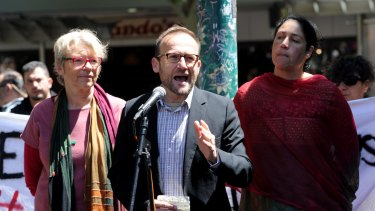Greens MP Adam Bandt addresses protesters at a rally in Melbourne on Saturday.