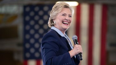 Hillary Clinton smiles as she arrives to speak at a rally at Goodyear Hall and Theater in Akron, Ohio on Monday.