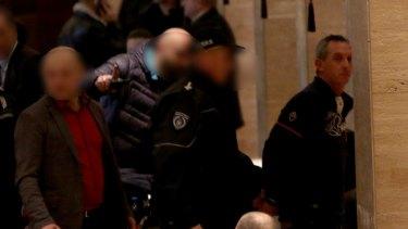 Serbian police arrest Australian Rohan Arnold, right, during a raid at the Metropol Palas Hotel, Belgrade, on January 16.