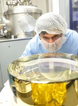 CSIRO technicians work on one of the mirrors that was used in LIGO in the detection of gravitational waves.