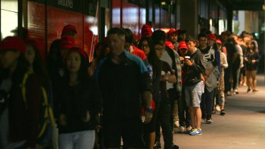 Crowds build outside David Jones City store, Sydney, in the early hours of the morning.