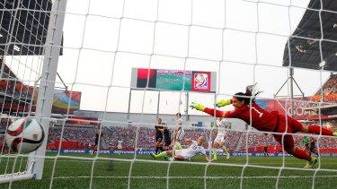 Net result: Australia's Lisa De Vanna hammers a goal past diving US goalkeeper Hope Solo.