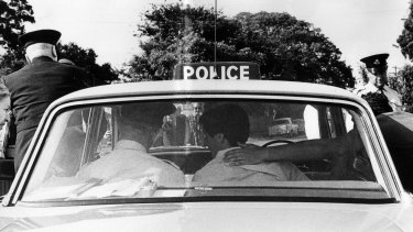 William White is arrested by police at his Gladesville home in November, 1966.