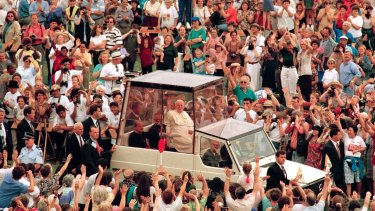 Pope John Paul II waves to the crowd on his way to preside over the Mass beatifying Mary MacKillop, Sydney,  January 19, 1995.