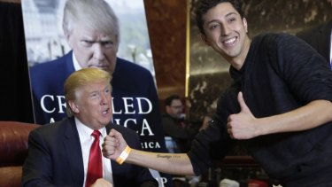"""Jason Szkup of Leivittown, New York, shows his """"Trump 2016"""" tattoo to Republican presidential candidate Donald Trump as Trump autographs copies of his new book at Trump Tower, in New York."""
