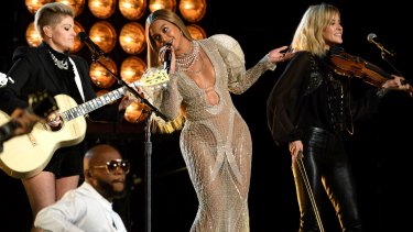 Beyonce wears a J'Aton dress as she performs with the Dixie Chicks at the Country Music Awards in Nashville on Wednesday.