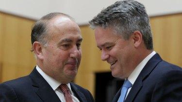 Secretary of Treasury John Fraser and Finance Minister Senator Mathias Cormann.