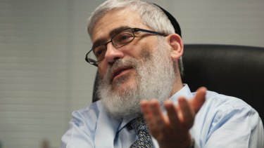 Joe Gutnick says he will fight a $55.5 million law suit brought by an Indian fertiliser collective.