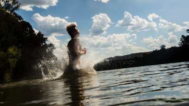 A man cools off in the Nepean River in Penrith on Sunday.