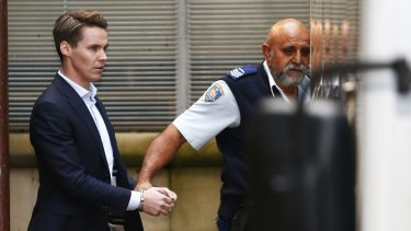 Insider trader Oliver Curtis is escorted to a prison truck after being sentenced to two years in jail.