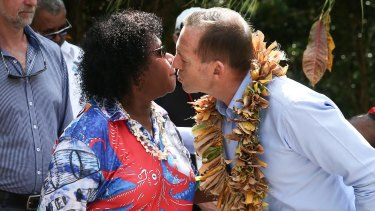 Gail Mabo and Prime Minister Tony Abbott during their visit to the grave of Eddie Mabo on Mer Island.