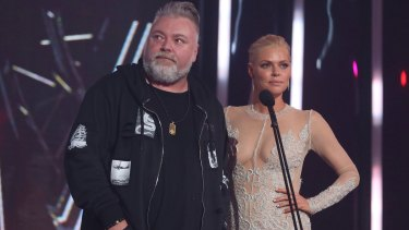 Sophie Monk and Kyle Sandilands presenting at the ARIAs.