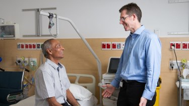 Dr Charles Brooker with Jaswir Grewal, who has received a spinal implant to relieve back pain, at Royal North Shore Hospital in St Leonards.
