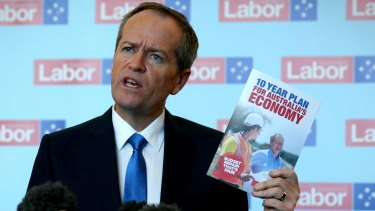 Mr Shorten with the Labor Party's election booklet.