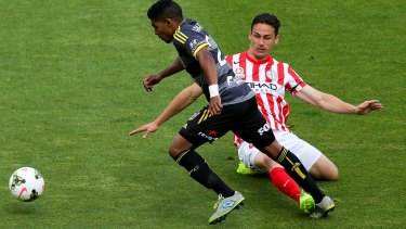 Archibald, right, playing for Melbourne City in 2014, tackling Roy Krishna.
