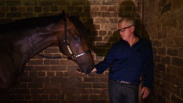 Tarzino with trainer Mick Price (right) at the Randwick High street stables, Sydney.