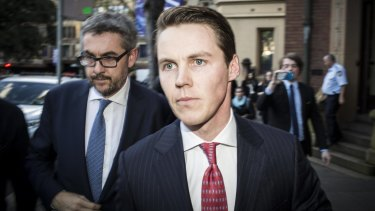 Oliver Curtis departs after a Supreme Court jury found him guilty of insider trading.