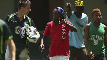 Shaun Marsh of Australia is approached by locals wanting match tickets.