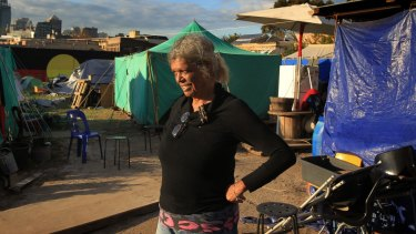 'Aunty Jenny' walks through the  Redfern Tent Embassy