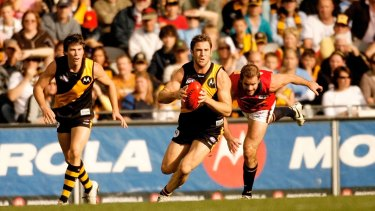 Joel Bowden outruns Mark Ricciuto during the Richmond Tigers match against Adelaide Crows at Telstra Dome. Photographed May 20, 2006, by John Donegan for Sunday Sport.