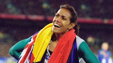 Cathy Freeman celebrates after winning the  Women's 400m Final at the Sydney Olympic Games in 2000. Her success epitomised Australia's self-belief.