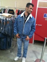 An Iranian Kurd had been found dead at Christmas Island. Fazel Chegeni trying on clothes at Savers in Melbourne.