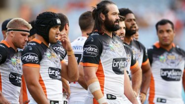 All too familiar: Aaron Woods and teammates gather behind the line.