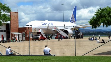 A United Airlines jet, diverted from Sydney, on the apron at RAAF Fairbairn in Canberra.