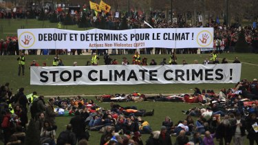 Activists gather during a demonstration on the final day of the COP21 conference in Paris.