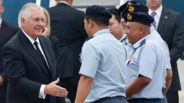US Secretary of State Rex Tillerson, left, is greeted by Malaysian Air Force officials at a military base in Subang.