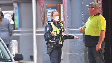 Police wearing masks near the scene of the fire.