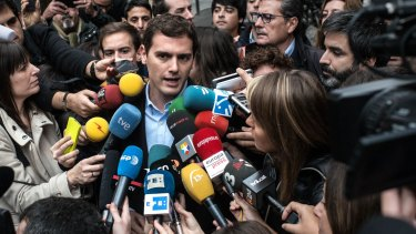 Ciudadanos (Citizens) leader Albert Rivera speaks to journalists after casting his vote at a polling station in Barcelona on Sunday.