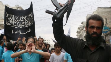 Al-Qaeda offshoot: Nusra Front supporters take part in a protest in Syria.