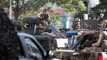 Security forces patrol Kabul after a suicide attack at the Iraqi embassy in Kabul on Monday.