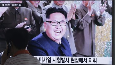 A TV news channel shows an image of North Korean leader Kim Jong-un.