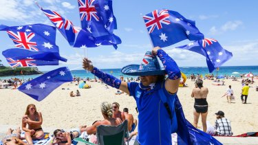 A flag seller on Coogee Beach on Australia Day 2016.