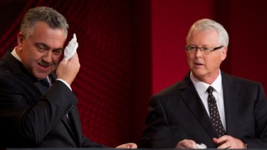 The impartiality of <i>Q&A</i> host Tony Jones, pictured with Treasurer Joe Hockey, will be examined in the review of the ABC program.