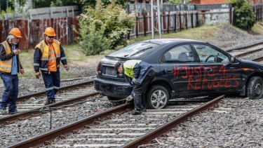 Protesters drove a car onto the railway tracks near Flemington to disrupt the Melbourne Cup Carnival.