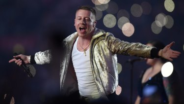 US artist Macklemore performs during the NRL grand final.