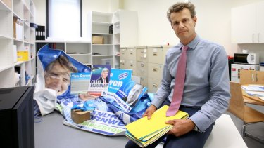 Declined to appear: Tim Crakanthorp in his Hunter Street, Newcastle, office with items he says were left behind by Tim Owen.