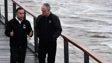 Liberal MP for Bass Andrew Nikolic and Prime Minister Malcolm Turnbull viewing the flooded Tamar River last week.