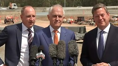 Queensland MP Luke Howarth - pictured with Prime Minister Malcolm Turnbull and Queensland Opposition Leader Tim Nicholls - has said he is sorry for dropping the f-bomb during the press conference.