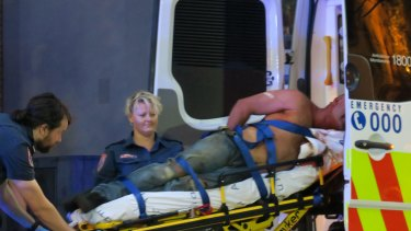 A man is taken to hospital after allegedly fighting with police during the Moomba festival.
