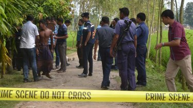 Bangladeshi security officers stand by the site where a Japanese Kunio Hoshi was killed at Mahiganj village in Rangpur district, 300 kilometers (185 miles) north of Dhaka, Bangladesh earlier this month.