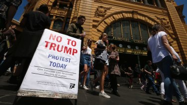 Protesters gather at Flinders Street Station.