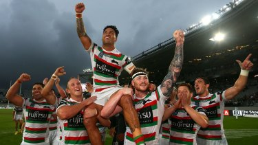 Redfern hero: Rabbitohs players hold captain Issac Luke on their shoulders as they celebrate winning the Auckland Nines.